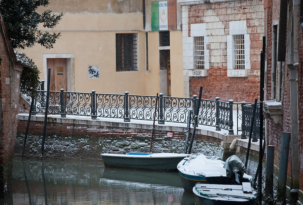 VENICE, ITALY - FEBRUARY 12:  Boats covered with snow are moored along a quiet canal on February 12, 2012 in Venice, Italy. Italy, like most of Europe, is experiencing freezing temperatures, with the Venice Lagoon freeezing for the first time in over 20 years.