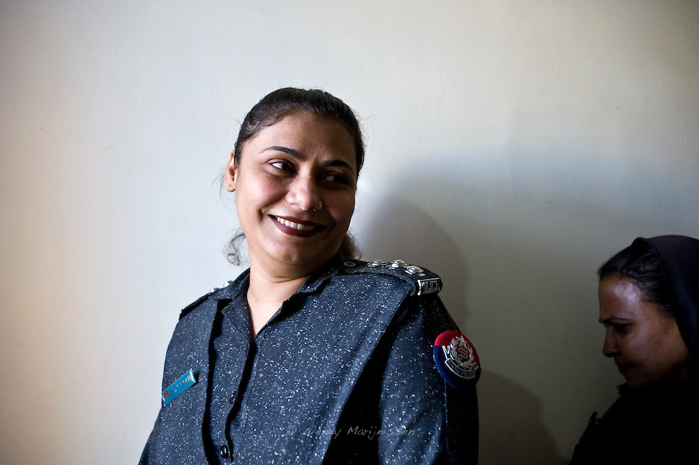 Lady police inspector Anila Unar of the West Karachi Police Station. <br /> In Pakistan there is no respect for female police officers.<br /> The system doesn't treat us like male police officers or constables and doesn't respect us.<br /> Even though I'm in a good position, often we are assigned duties outside Karachi like guarding the grave of former Prime Minister Benazir Bhutto.<br /> Karachi, Pakistan, 2011