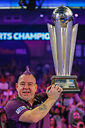WINNER Peter Wright (Scotland) holds the Sid Waddell trophy after his win over Michael Van Gerwen (Netherlands) (not in picture) in the final of the PDC William Hill World Darts Championship at Alexandra Palace, London, United Kingdom on 1 January 2020.