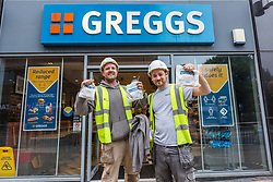 © Licensed to London News Pictures. 18/06/2020. Leeds UK. Builders leave a Greggs shop in Leeds city centre this morning as the store opens shops across the UK after the Covid-19 lockdown. Photo credit: Andrew McCaren/LNP
