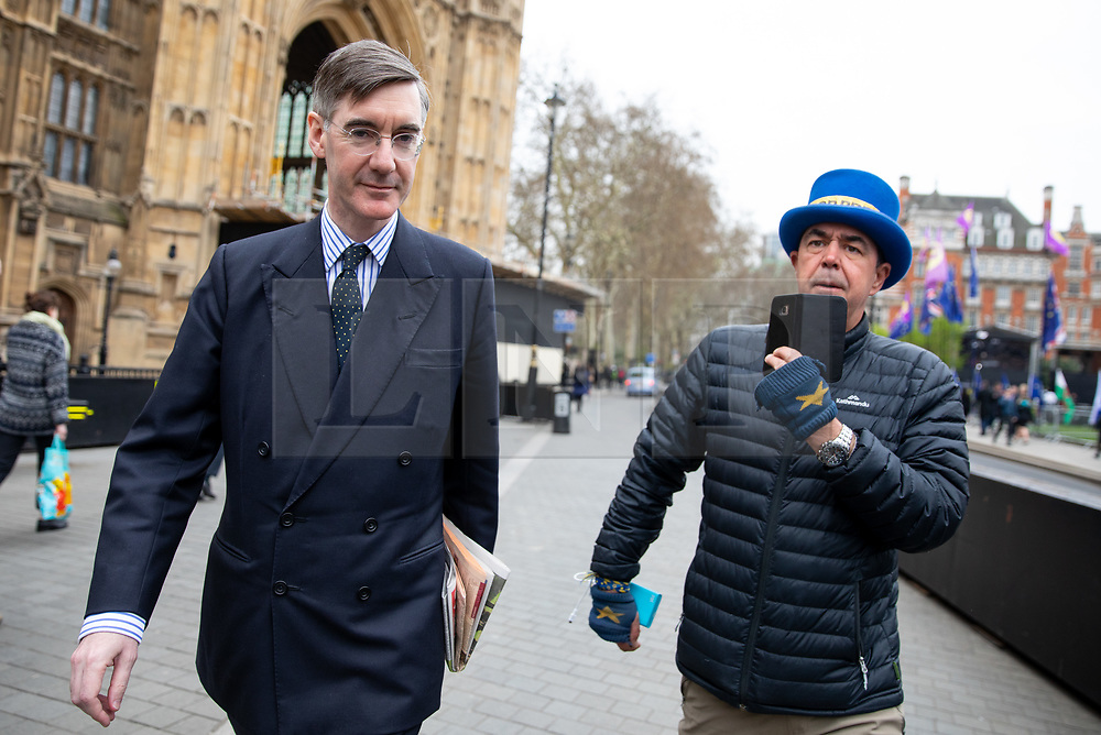 © Licensed to London News Pictures. 27/03/2019. London, UK. Jacob Rees-Mogg MP (left) speaks to anti-Brexit campaigner Steve Bray (right) on his walk to the Houses of Parliament in Westminster this morning. Later today MPs are expected to vote on a series of indicative votes on alternative proposals to British Prime Minister Theresa May's withdrawal agreement. Photo credit : Tom Nicholson/LNP