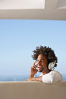 Young man listening to music through headphones portrait