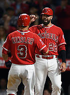 June 6, 2018 - Anaheim, CA, U.S. - ANAHEIM, CA - JUNE 06: Los Angeles Angels of Anaheim second baseman Ian Kinsler (3) is greeted at home plate by third baseman Kaleb Cowart (22) after Kinsler hit a two run home run in the sixth inning of a game against the Kansas City Royals played on June 6, 2018 at Angel Stadium of Anaheim in Anaheim, CA. (Photo by John Cordes/Icon Sportswire) (Credit Image: © John Cordes/Icon SMI via ZUMA Press)