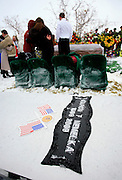 Mourners pay their final respects after a burial ceremony for U.S. Army Pfc. Aaron Nemelka at Camp Williams, Saturday Nov. 14, 2009 in Riverton, Utah. Nemelka was one of 13 gunned down at Fort Hood, Texas. (AP Photo/Colin Braley)