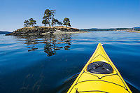 The bow of a sea kayak on the water near Turn Island in the San Juan Islands of Washington State, USA.