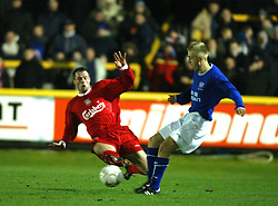 SOUTHPORT, ENGLAND - Tuesday, January 13, 2004: Liverpool's Jamie Carragher makes his return from injury against Everton's Stephen Wynne during the 'mini-Derby' Premier League reserve match at Haige Avenue. (Pic by David Rawcliffe/Propaganda)