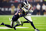 HOUSTON, TX - AUGUST 29:  Nsimba Webster #14 of the Los Angeles Rams is tackled by Chris Johnson #43 of the Houston Texans during week four of the preseason at NRG Stadium on August 29, 2019 in Houston, Texas. The Rams defeated the Texans 22-10.   (Photo by Wesley Hitt/Getty Images) *** Local Caption *** Nsimba Webster; Chris Johnson