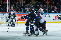 KELOWNA, CANADA - DECEMBER 30: Tyler Soy #17 and Ralph Jarratt #4 of the Victoria Royals check Kole Lind #16 of the Kelowna Rockets during first period on December 30, 2017 at Prospera Place in Kelowna, British Columbia, Canada.  (Photo by Marissa Baecker/Shoot the Breeze)  *** Local Caption ***