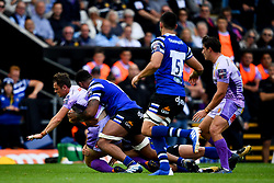 Tom Wyatt of Exeter Chiefs is tackled by Levi Douglas of Bath Rugby - Mandatory by-line: Ryan Hiscott/JMP - 21/09/2019 - RUGBY - Sandy Park - Exeter, England - Exeter Chiefs v Bath Rugby - Premiership Rugby Cup