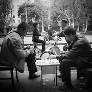 China, Shanghai. people playing chinese game in the streets