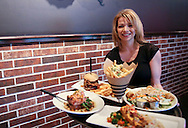 Server Nicole Page holds a tray of food at Zeppelins Bar & Grill, 5300 Edgewood Road NE, in Cedar Rapids on Monday, August 6, 2012.