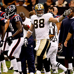 August 21, 2010; New Orleans, LA, USA; New Orleans Saints tight end Jeremy Shockey (88) signals he was interfered with by Houston Texans safety Bernard Pollard (31) during the first quarter of a preseason game at the Louisiana Superdome. Mandatory Credit: Derick E. Hingle