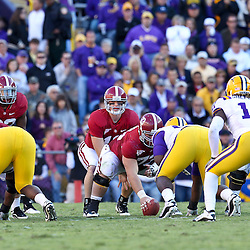 November 6, 2010; Baton Rouge, LA, USA;  Alabama Crimson Tide quarterback Greg McElroy (12) under center against the LSU Tigers during the second half at Tiger Stadium. LSU defeated Alabama 24-21.  Mandatory Credit: Derick E. Hingle