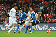 England striker Harry Kane bursts away from Estonia defender Karol Mets during the Group E UEFA European 2016 Qualifier match between England and Estonia at Wembley Stadium, London, England on 9 October 2015. Photo by Alan Franklin.
