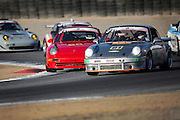 Image of Porsche 911s racing a spec race at Mazda Raceway Laguna Seca at Rennsport Reunion V in Monterey, California, America west coast