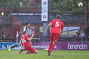 Keith Lowe just gets ahead of Aleksandar Mitrovic to clear the ball during the Pre-Season Friendly match between York City and Newcastle United at Bootham Crescent, York, England on 29 July 2015. Photo by Simon Davies.