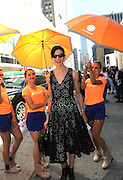 IMAGE DISTRIBUTED FOR ACCUWEATHER -  Amy Fine Collins is shaded from the hot summer sun by the AccuWeather MinuteCast street team at New York Fashion Week, on Tuesday, Sept. 15, 2015. The AccuWeather MinuteCast Street Team is at it again helping Fashion Week attendees stay stylish and one-step ahead of any possible precipitation. (Photo by Diane Bondareff/Invision for AccuWeather/AP Images)