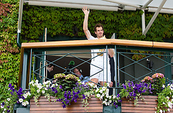 LONDON, ENGLAND - Sunday, July 10, 2016:  Andy Murray (GBR) waving to the crowd on the balcony and holding the Gentlemen's Singles Trophy following his victory in the Gentlemen's Singles Final match against Milos Raonic (CAN) on day fourteen of the Wimbledon Lawn Tennis Championships at the All England Lawn Tennis and Croquet Club. (Pic by Kirsten Holst/Propaganda)