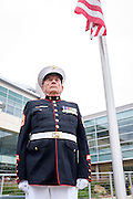 Denny Weisgerber, former Milpitas Mayor and United States Marine Corps Gunnery Sergeant, stands during the playing of the Armed Forces Salute during the Memorial Day Ceremony at City Hall in Milpitas, California, on May 25, 2015. (Stan Olszewski/SOSKIphoto)