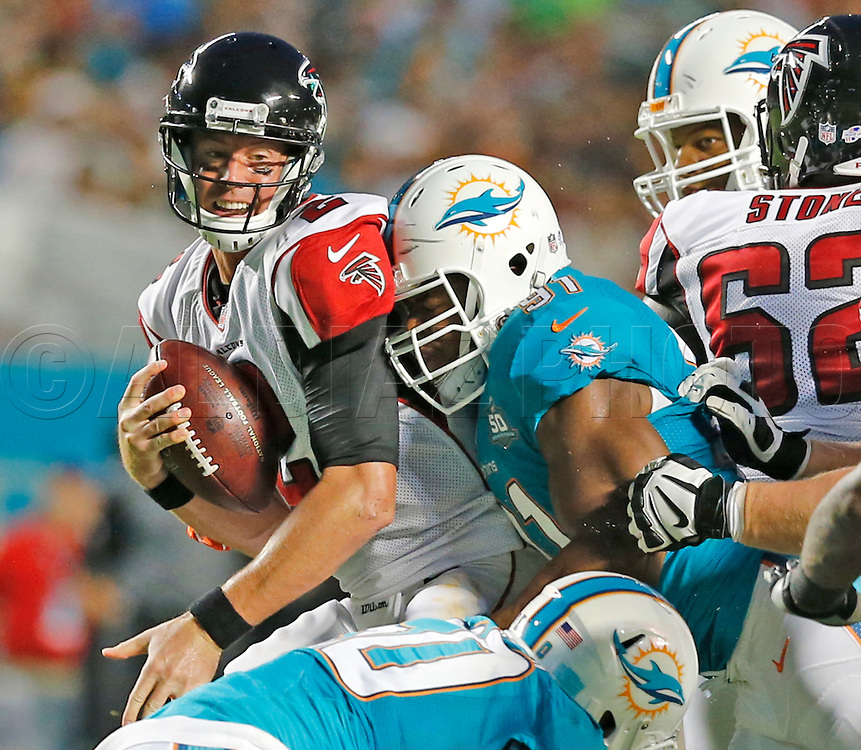 Atlanta Falcons quarterback Matt Ryan (2) is sacked by Miami Dolphins defensive end Cameron Wake (91) in the second quarter during the Miami Dolphins' exhibition game against the Atlanta Falcons at Sun Life Stadium on Saturday, August 29, 2015.
