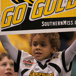 21 December 2008:  A Southern Miss fan in the stands during 30-27 overtime victory by the Southern Mississippi Golden Eagles over the Troy Trojans in the  R+L Carriers New Orleans Bowl at the New Orleans Superdome in New Orleans, LA.
