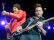 Michael Franti and guitarist J Bowman jam one of Spearhead's songs Saturday at the Rendezvous Festival.