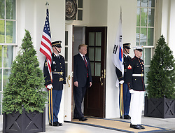 United States President Donald J. Trump emerges from the White House to welcome President Moon Jae-in of South Korea for talks at the White House in Washington, DC, USA on Tuesday, May 22, 2018. The two leaders are meeting ahead of President Trump's scheduled summit with Kim Jung-un of North Korea which is tentatively scheduled for June 12, 2018 in Singapore. Photo by Ron Sachs/CNP/ABACAPRESS.COM