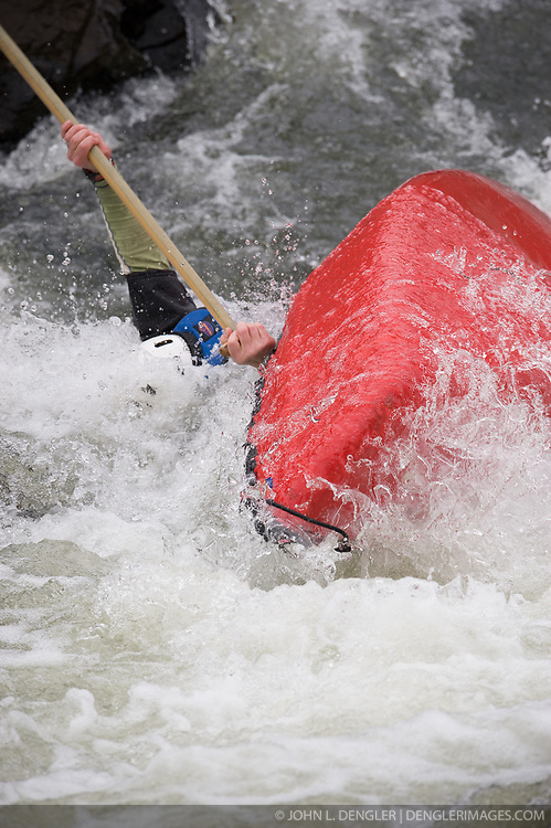 Stephen Finch races in the OC1 men's plastic during the slalom course of the 42nd Annual Missouri Whitewater Championships. Finch overturned and did not finish his run. The Missouri Whitewater Championships, held on the St. Francis River at the Millstream Gardens Conservation Area, is the oldest regional slalom race in the United States.