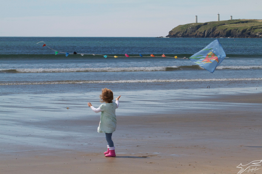 I saw this young girl flying her kite on Tramore Beach one windy day, here is a post I wrote a long time ago, it seems now, of my family on the beach there in the 1920's  http://foxglovelane.blogspot.ie/2011/03/waterford-seaside-1920s.html