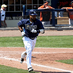 March 20, 2011; Port Charlotte, FL, USA; Tampa Bay Rays left fielder Manny Ramirez (24) during a spring training exhibition game against the Baltimore Orioles at Charlotte Sports Park.   Mandatory Credit: Derick E. Hingle