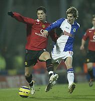 Photo: Aidan Ellis.<br /> Blackburn v Manchester United. Barclays Premiership. 01/02/2006.<br /> Blackburn's Morten Gamst Pedersen challenges United's  Cristiano Ronaldo