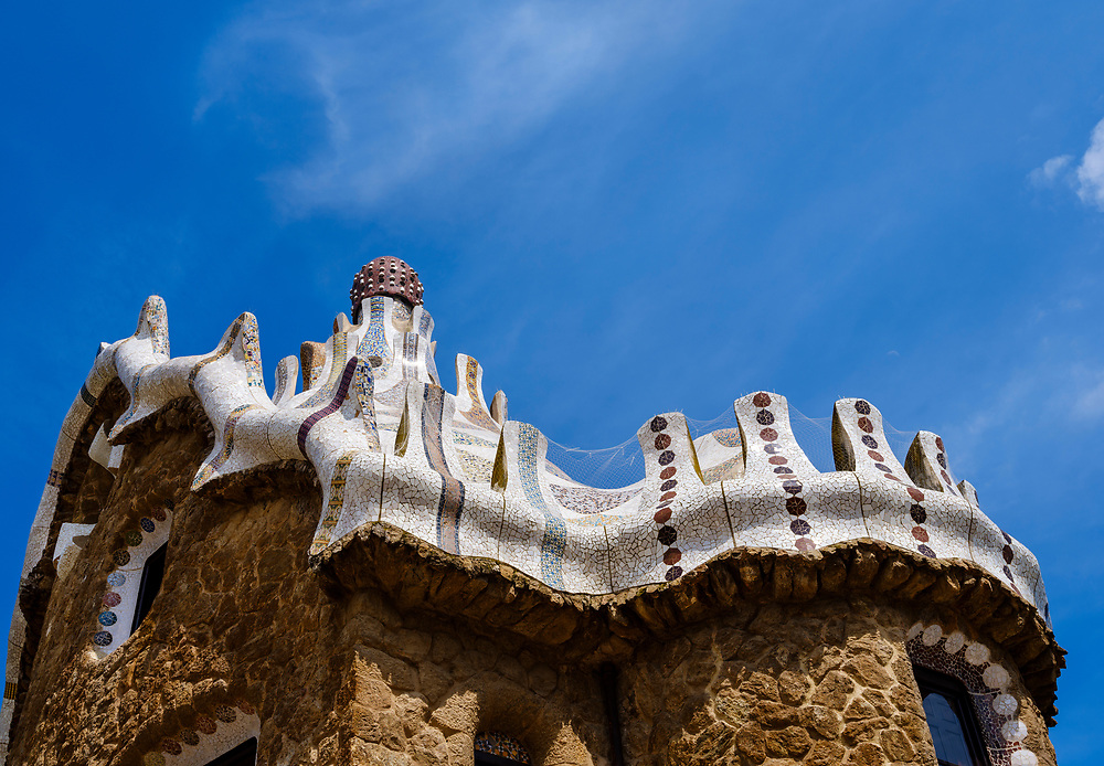 BARCELONA, SPAIN - CIRCA MAY 2018: Entrance pavilion of Parc Güel. Parque Güell is a public park system composed of gardens and architectonic elements located on Carmel Hill, in Barcelona, Catalonia, Spain. It was designed by Antoni Gaudi and it is a popular tourist destination.