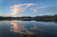 Clouds illuminated by setting sun at Dream Lake. Bridger Wilderness, Wind River Range, Wyoming