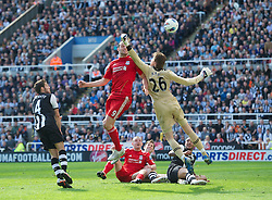 NEWCASTLE-UPON-TYNE, ENGLAND - Sunday, April 1, 2012: Liverpool's Andy Carroll in action against Newcastle United's goalkeeper Tim Krul during the Premiership match at St James' Park. (Pic by David Rawcliffe/Propaganda)