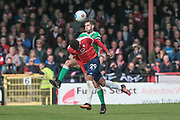 Mark Carrington (Captain) (Wrexham AFC) wins the header over Vadaine Oliver (York City) during the Vanarama National League match between York City and Wrexham FC at Bootham Crescent, York, England on 17 April 2017. Photo by Mark P Doherty.