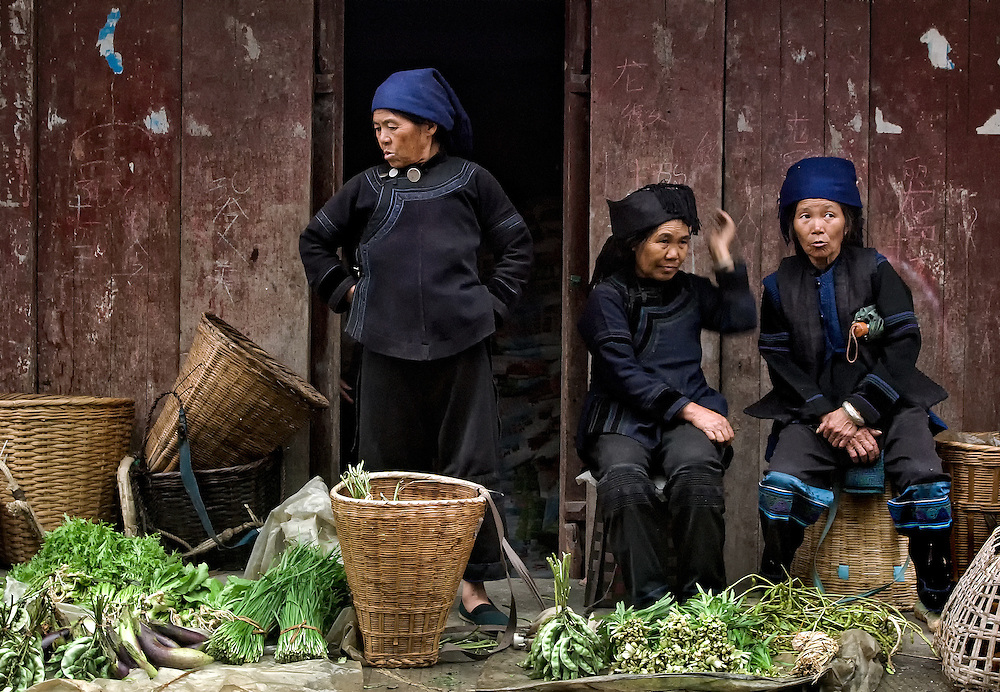 Hani woman  at the market selling their farm grown produce in Yuanyang, Yunnan, China.