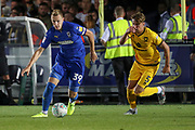 AFC Wimbledon striker Joe Pigott (39) taking on Milton Keynes Dons defender Regan Poole (5) during the EFL Cup match between AFC Wimbledon and Milton Keynes Dons at the Cherry Red Records Stadium, Kingston, England on 13 August 2019.