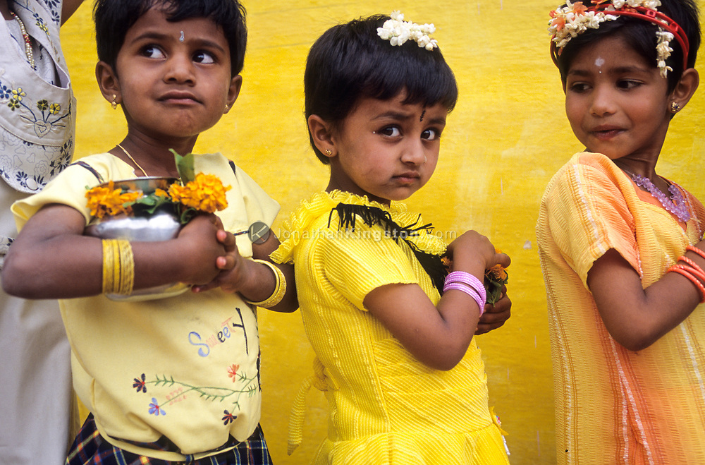 Young girls carry pots of water during a festival in Tamil Nadu, India.