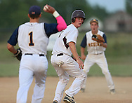 Mount Vernon's Conner Welch (7) eyes Regina's John Ries (1) as he is caught in a rundown during the 2A District Finals game at West Branch High School in West Branch on Saturday, July 20, 2013.