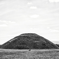 Silbury Hill with two lone figures and fields