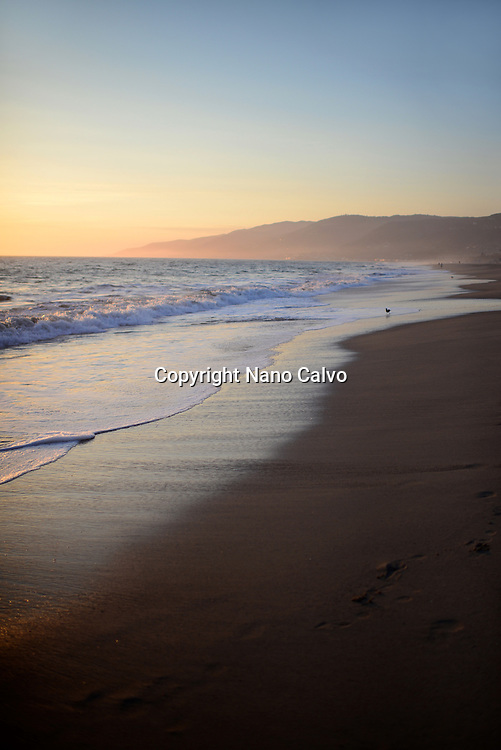 Zuma beach in Malibu at sunset, California.