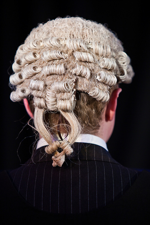 A barrister wearing the wig that is worn in a crown court in England.