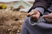 Prayer beads and the faithful. Dec. 28, 2013. West Bank, Palestinian Territories. (Photo by Gabriel Romero/Alexia Foundation ©2014)