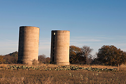 Twin concrete silos for the Thurber Dairy, Thurber, Texas, United States of America