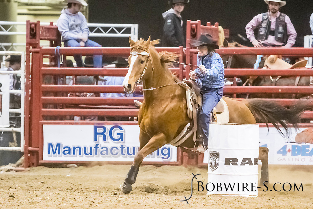 Mary Vroman makes her barrel run at the Bismarck Rodeo on Friday, Feb. 2, 2018. She ran an 18.29.