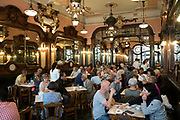 Diners in the famous traditional Majestic Cafe in Santa Catarina, Porto, Portugal