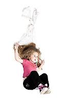 caucasian little girl sliding with blanket isolated studio on white background