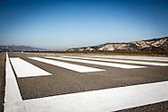 Pisticci Scalo, Basilicata, Italia 27/01/2016 <br /> La pista di atterraggio, lunga 1.440 mt, dell'aviosuperficie &quot;E.Mattei&quot;, dove al momento possono atterrare aerei da massimo nove posti<br /> <br /> La struttura venne realizzata negli anni '60, durante l'industrializzazione della val Basento, su iniziativa di Enrico Mattei, per una sua personale maggiore rapidit&agrave; di spostamento tra i siti ENI.<br /> <br /> Inutilizzata per molto tempo. Il 22 maggio 2014 &egrave; stata affidata dal CSI (consorzio per lo sviluppo industriale) di Matera la gestione della stessa aviosuperficie alla societ&agrave; aerotaxi Winfly, che ha sede all'Aeroporto di Pontecagnano, vicino Salerno.<br /> <br /> Pisticci Scalo, Basilicata, Italy, 27/01/2016<br /> The landing strip of the airstrip &quot;E. Mattei&quot;. It is 1440 meter long and it allows the landing to airplanes with a maximum capacity of nine seats.<br /> Also named as &quot;Airfield of Basilicata&quot;, it is located in Pisticci Scalo, near Matera.<br /> <br /> The structure, a simple airstrip, was built in the 60s, during the industrialization of the Basento valley, on the initiative of Enrico Mattei, for a faster personal transfer between ENI company sites.<br /> <br /> Unused for a long time. On the 22nd May 2014 the CSI (Consortium for Industrial Development) of Matera entrusted the management of the airfield to the air taxi Winfly company, based in the Airport of Pontecagnano near Salerno.
