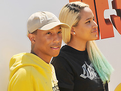 """(L-R) Pharrell Williams and Helen Lasichanh arrives at the """"Despicable Me 3"""" Los Angeles Premiere held at the Shrine Auditorium in Los Angeles, CA on Saturday, June 24, 2017.  (Photo By Sthanlee B. Mirador) *** Please Use Credit from Credit Field ***"""
