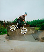 Boy on his BMX in the air, UK 2001.